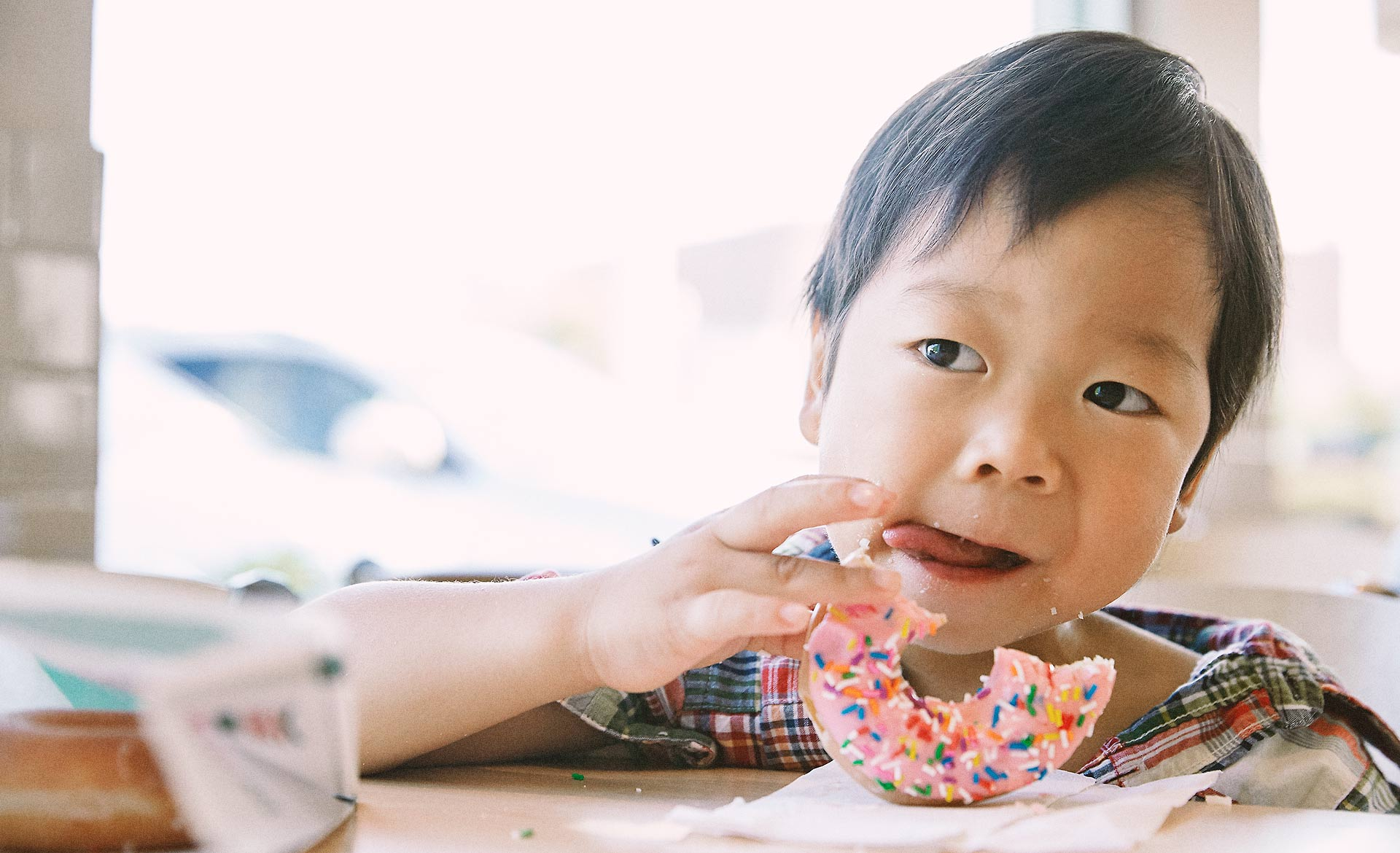 Japanese boy eating a donut