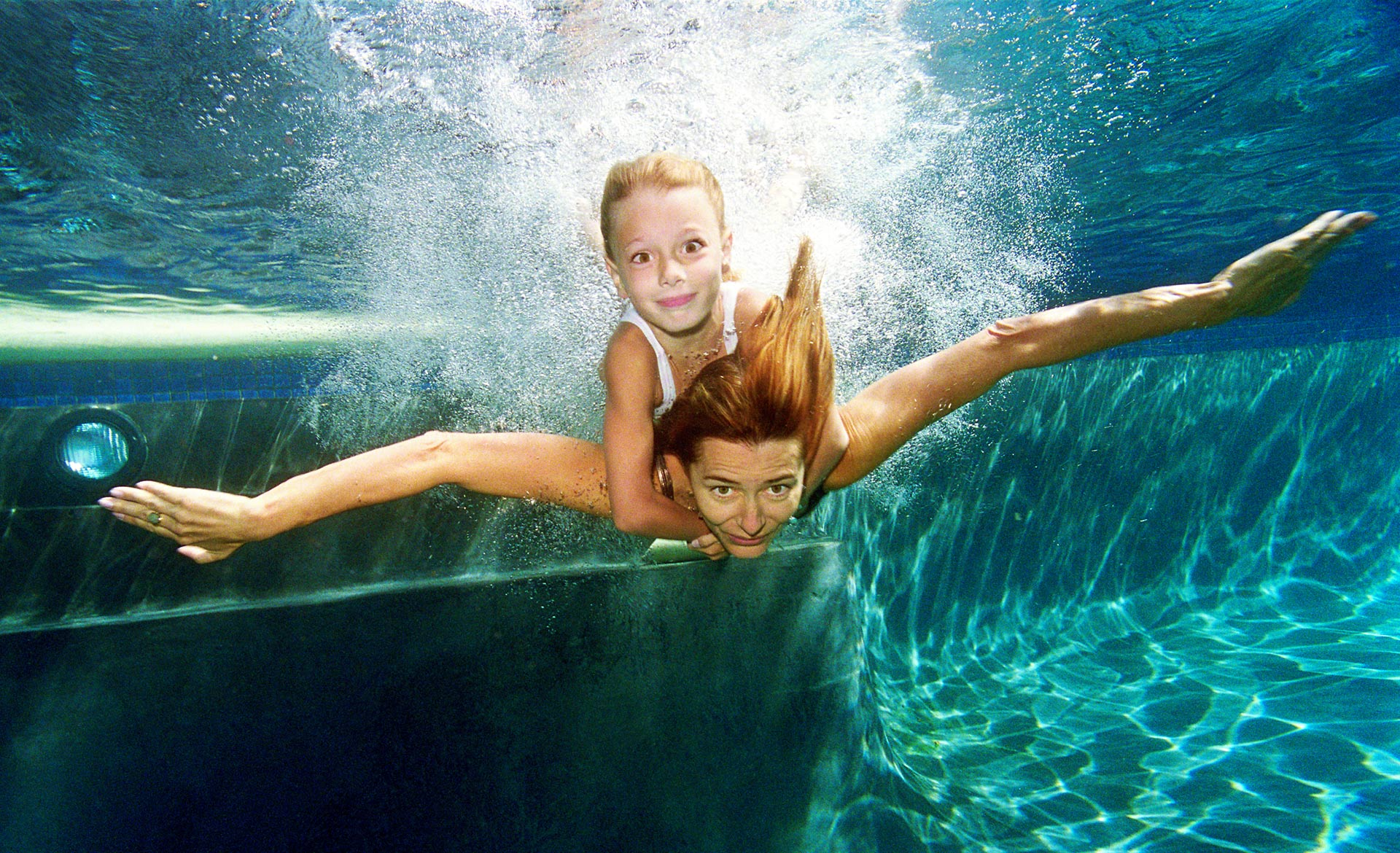 Mom with daughter underwater