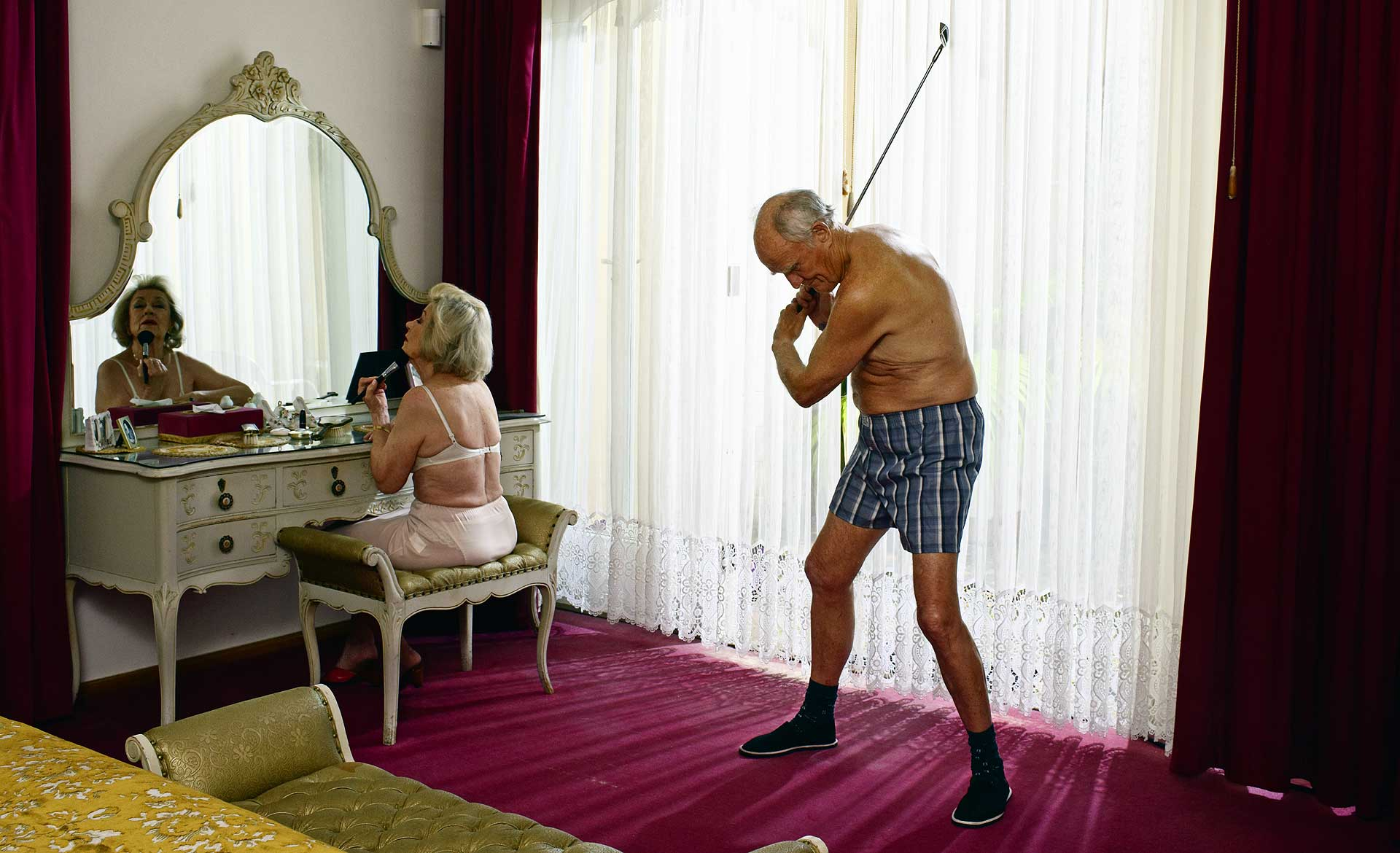 Granddad practicing Golf in bedroom